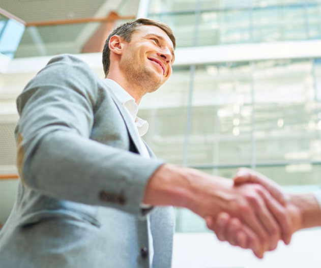man shaking hand and smiling